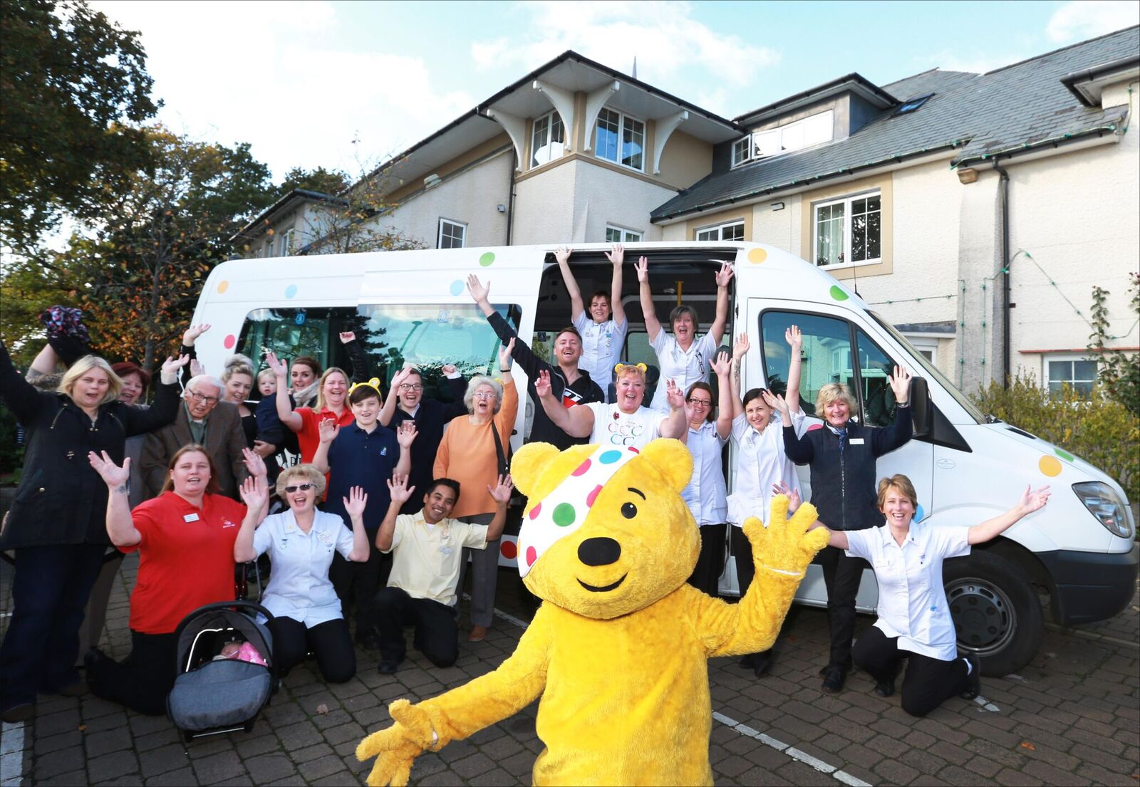 Colten Care New Forest staff with Children in Need Pudsey Bear