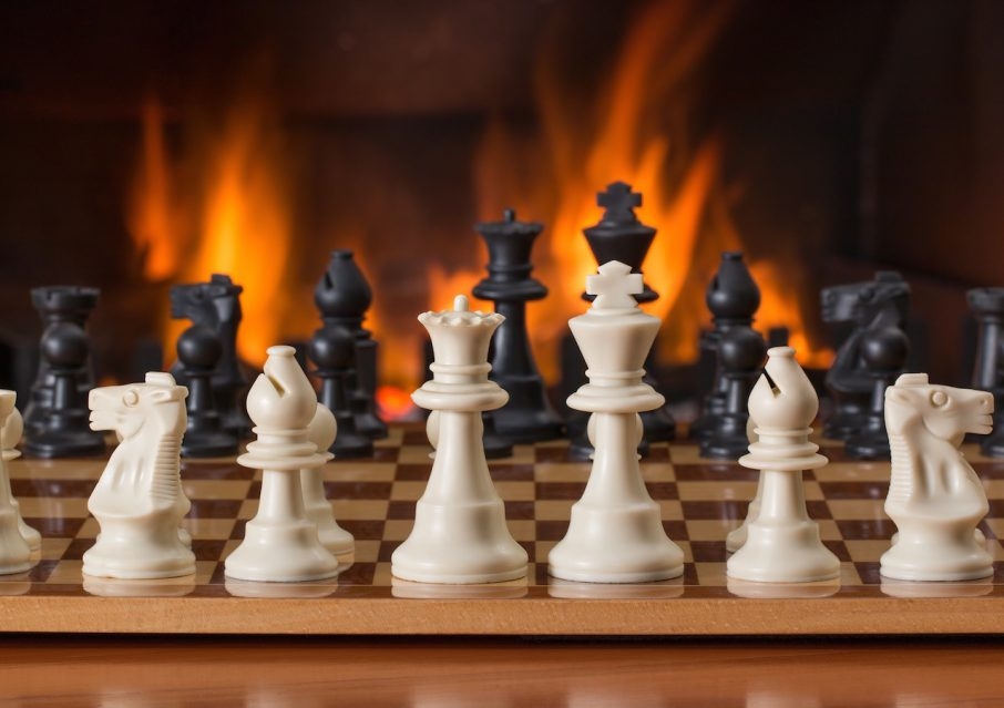 Competitive advantage - chess in front of the fire