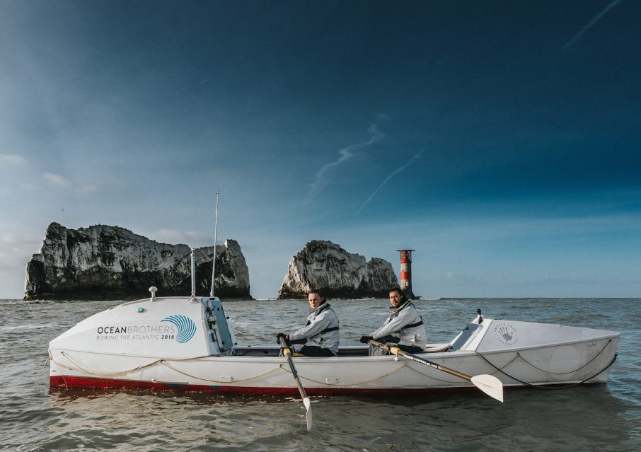 Ocean Brothers sponsorship by Bartley Marketing rowing their boat past the Needles as they prepare for their Transatlantic row